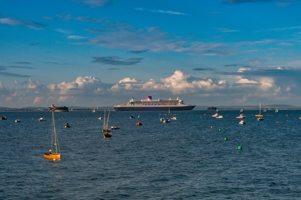 Photograph of the Queen Mary 2 sailing out of Cowes