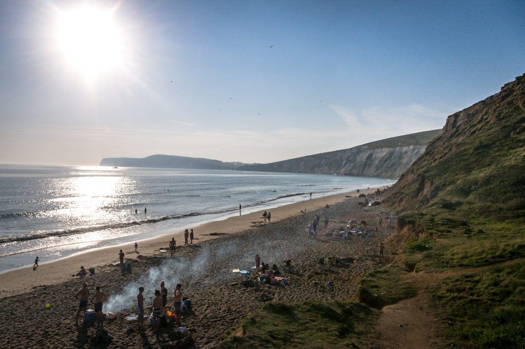 Photograph of a beach bathed in evening sunshine in late summer